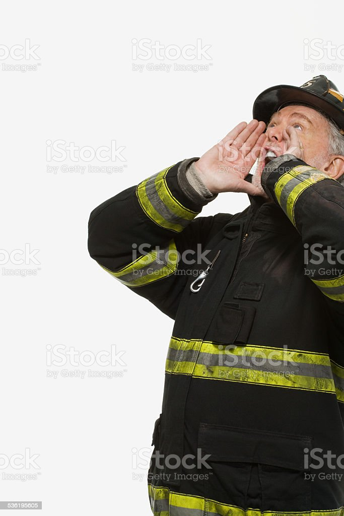 Portrait of a firefighter shouting stock photo