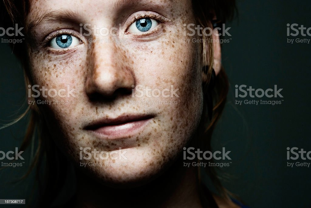 A portrait of a freckled face woman with blue eyes stock photo