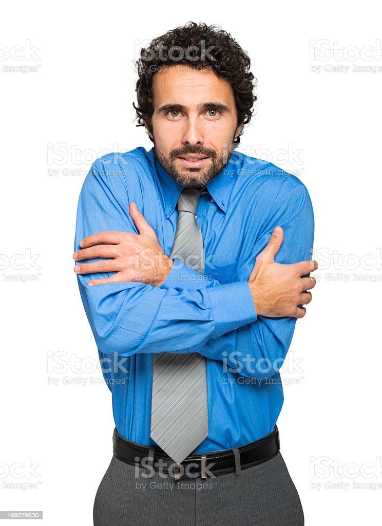 Portrait of a freezing businessman stock photo