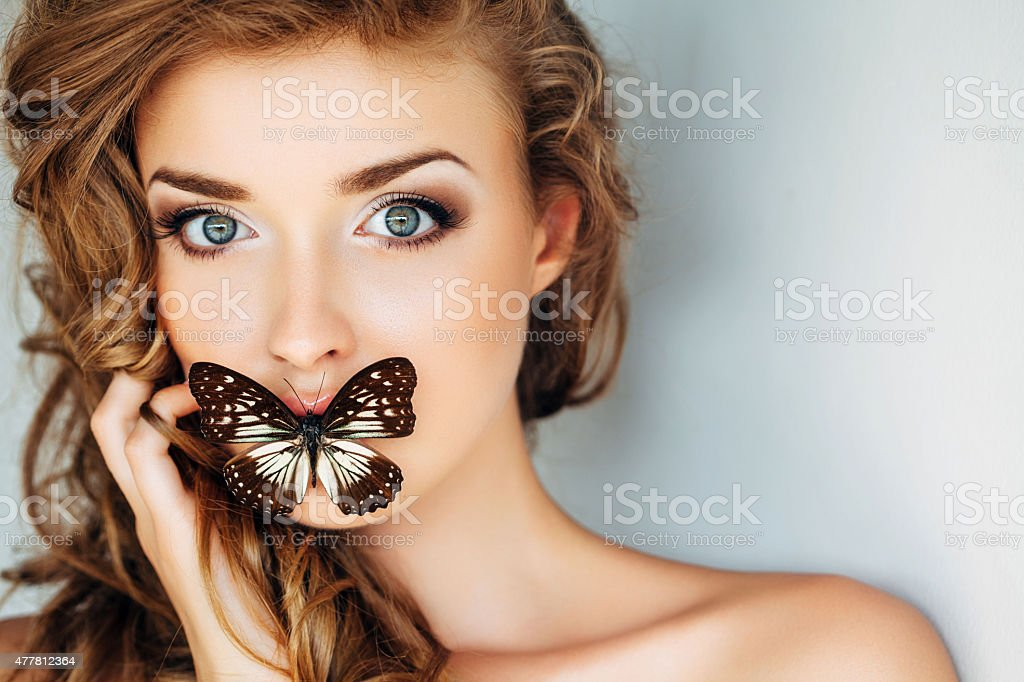 Portrait of a fresh and lovely woman with butterfly stock photo