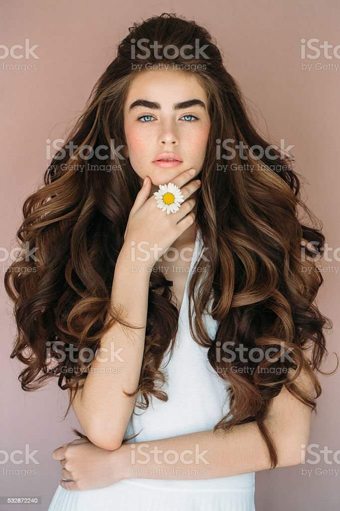 Portrait of a fresh and lovely woman with flower stock photo