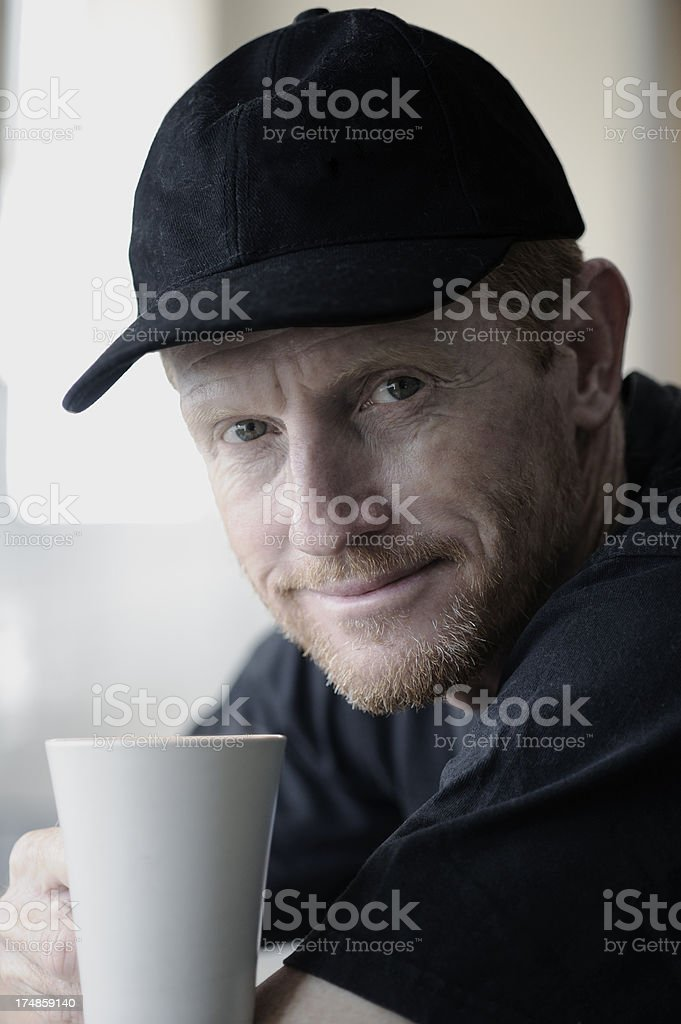 Portrait of a friendly middle-aged man with coffee mug royalty-free stock photo