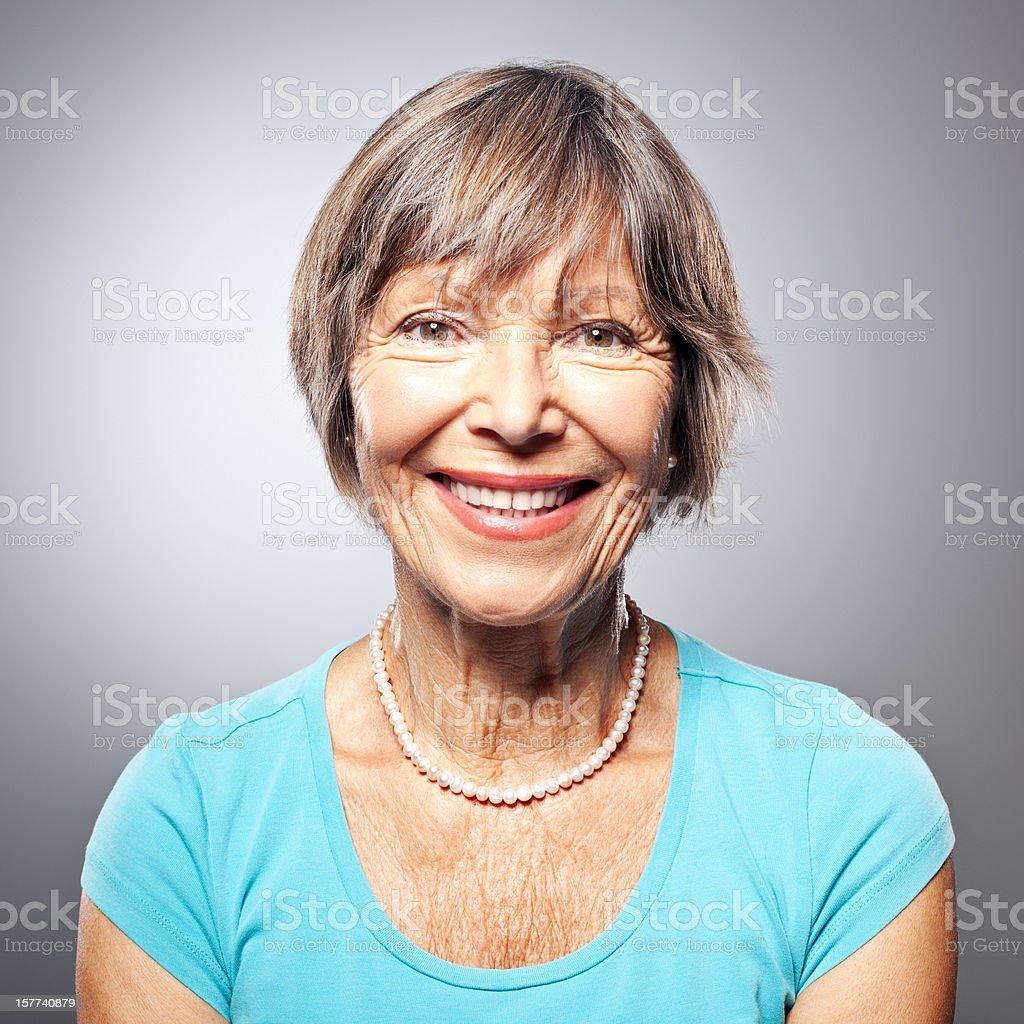 Portrait of a friendly smiling senior woman stock photo