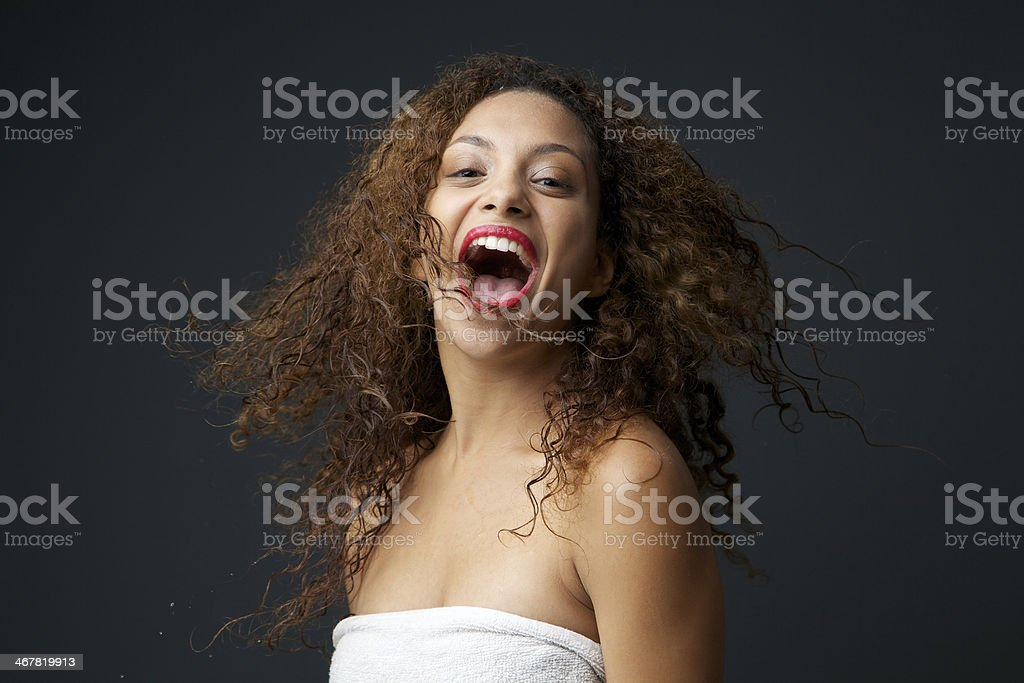 Portrait of a fun young carefree woman laughing royalty-free stock photo