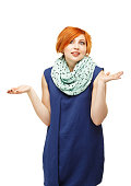 portrait of a funny red-haired girl emotionally gesticulating an