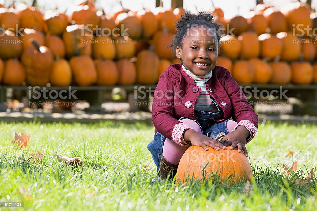 Portrait of a girl and a pumpkin royalty-free stock photo