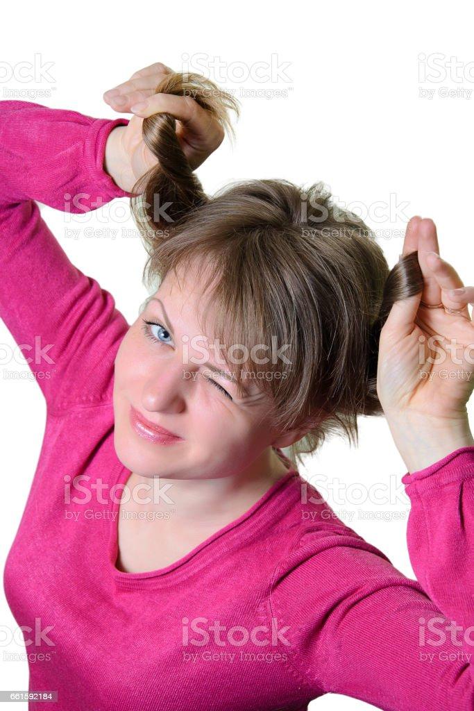 Portrait of a girl cheerful. Blinks an eye. stock photo