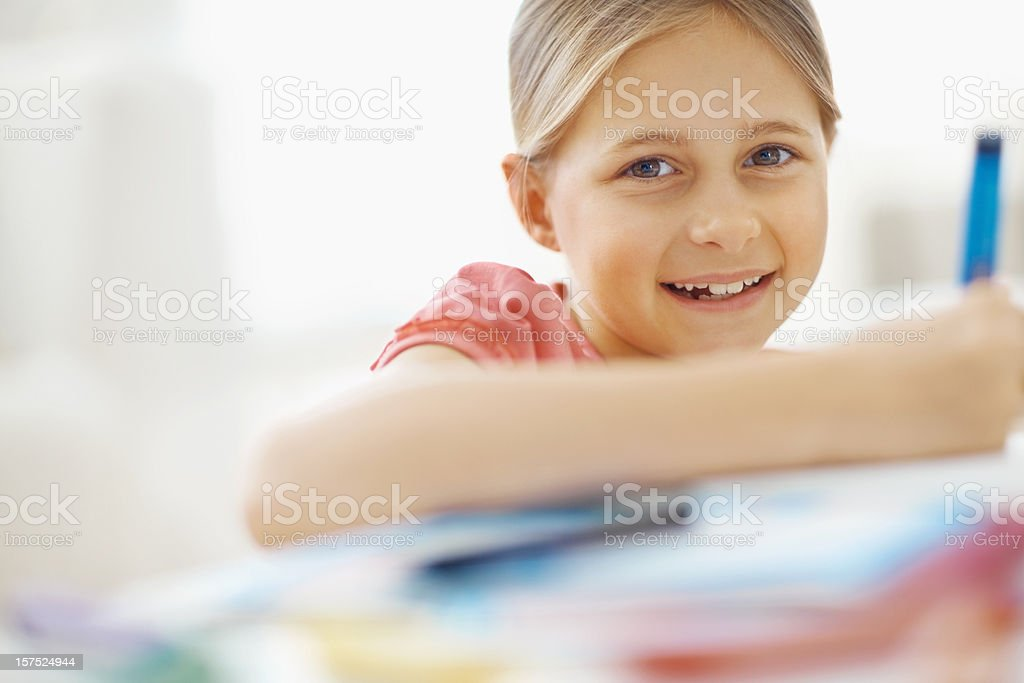 Portrait of a girl doing her homework royalty-free stock photo