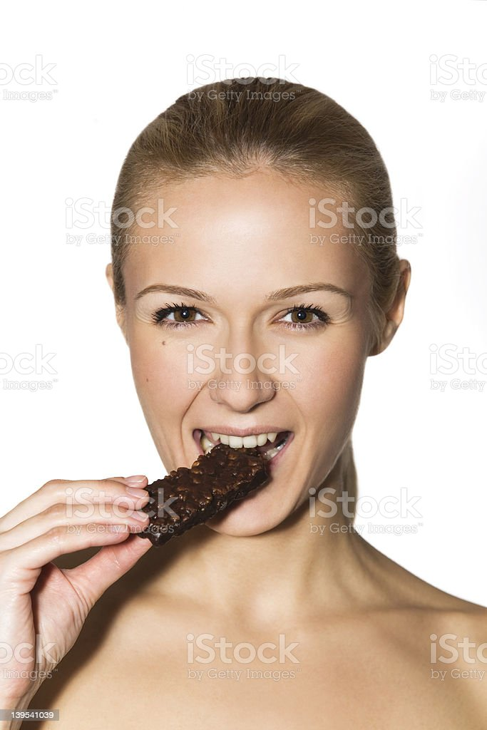 portrait of a girl eating chocolate royalty-free stock photo