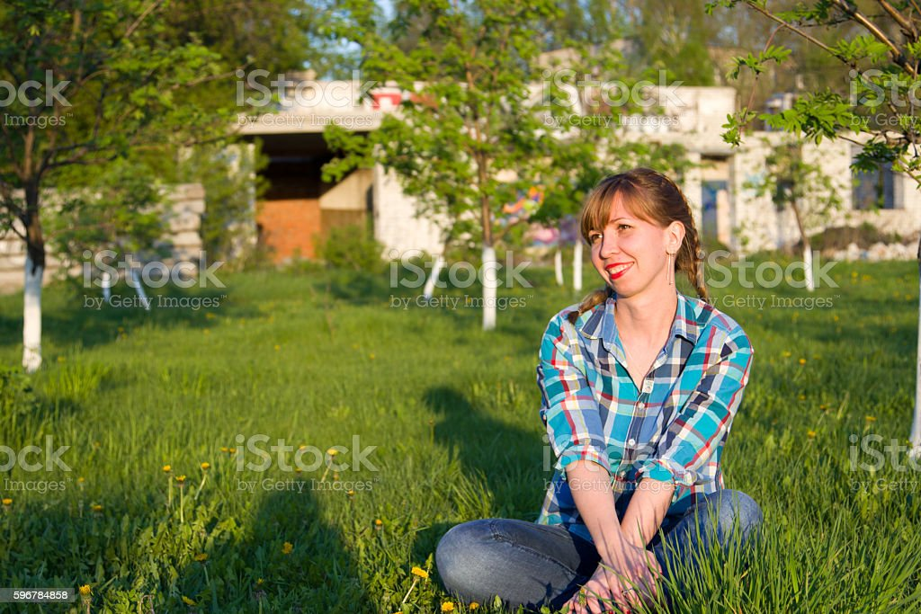 Portrait of a girl in a park stock photo
