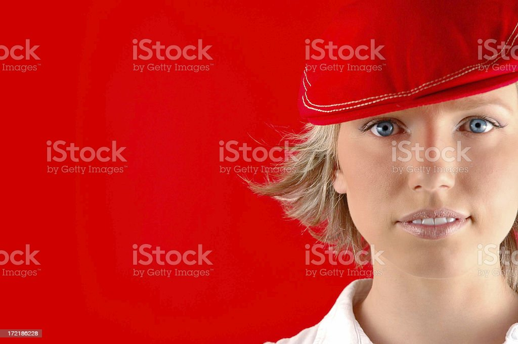 Portrait of a girl in a red hat royalty-free stock photo