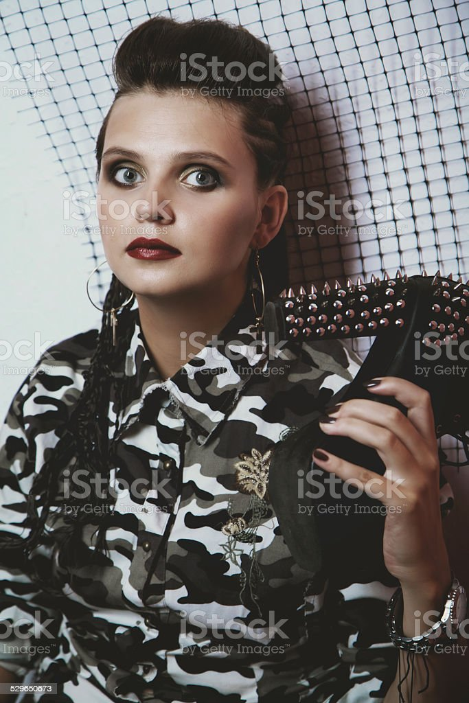 Portrait of a girl in camouflage clothing stock photo