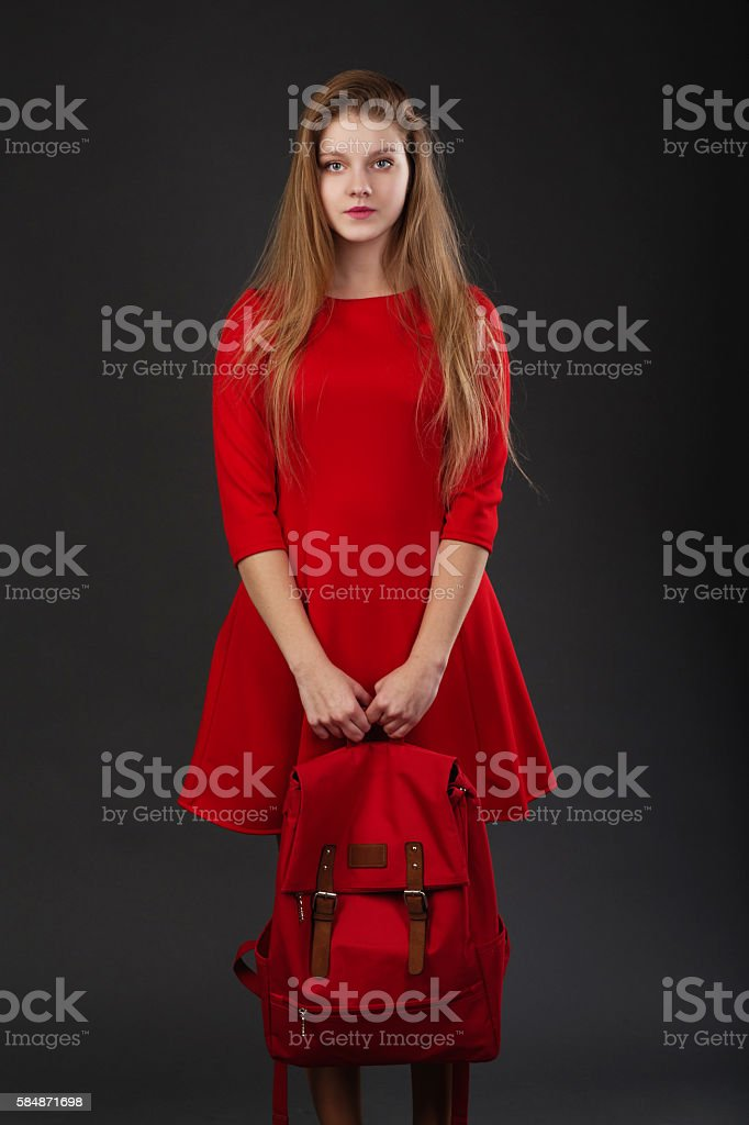 Portrait of a girl in red dress stock photo