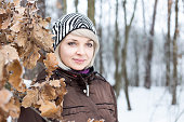 Portrait of a girl in the winter forest.