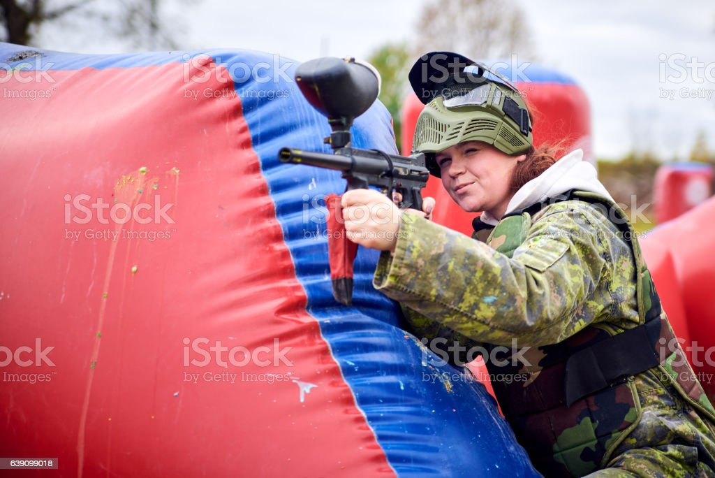 Portrait of a girl in uniform takes aim stock photo