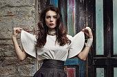 Portrait of a girl model in a beautiful dress.