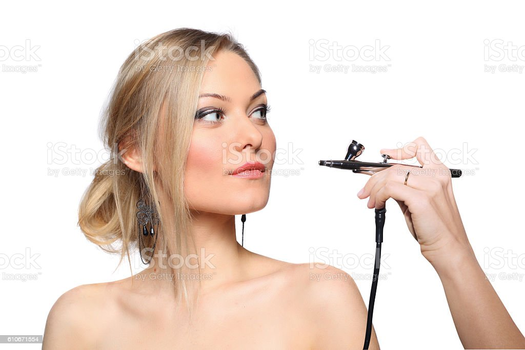 portrait of a girl model with hand airbrush stock photo