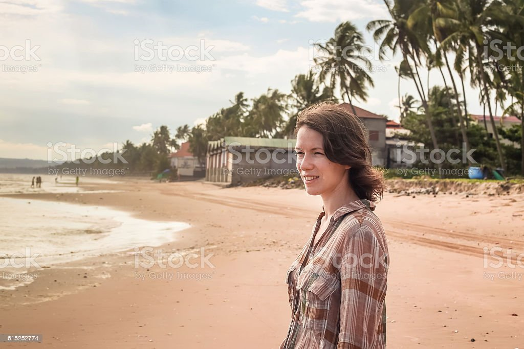 Portrait of a girl on the sea stock photo