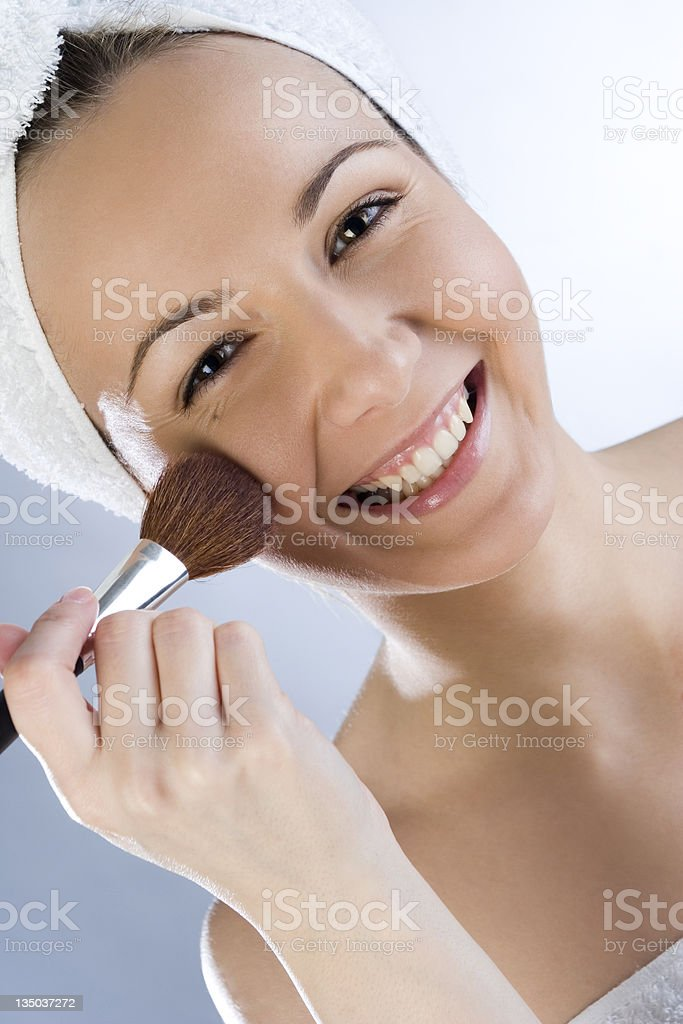 portrait of a girl putting makeup royalty-free stock photo
