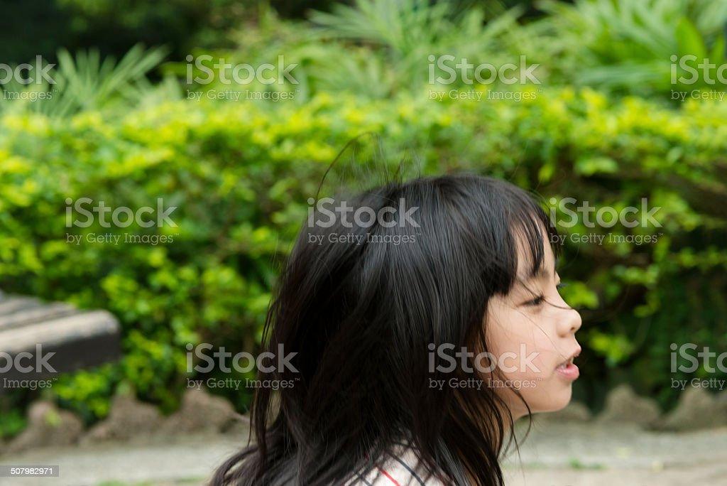 Portrait of a Girl Running Hong Kong Park, China royalty-free stock photo