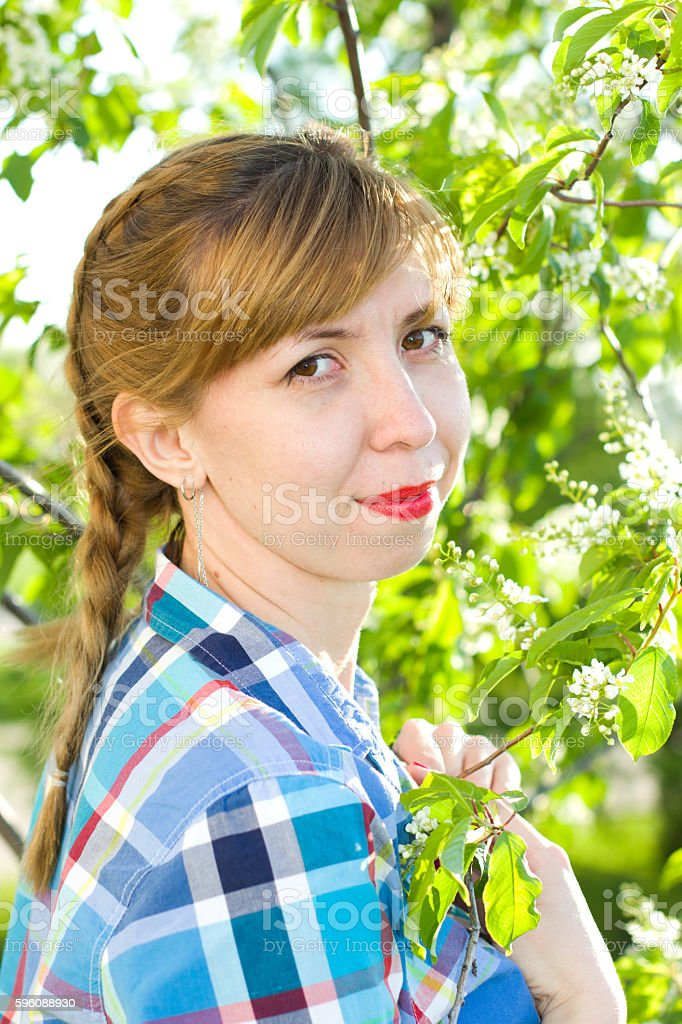 Portrait of a girl with a bird-cherry tree stock photo