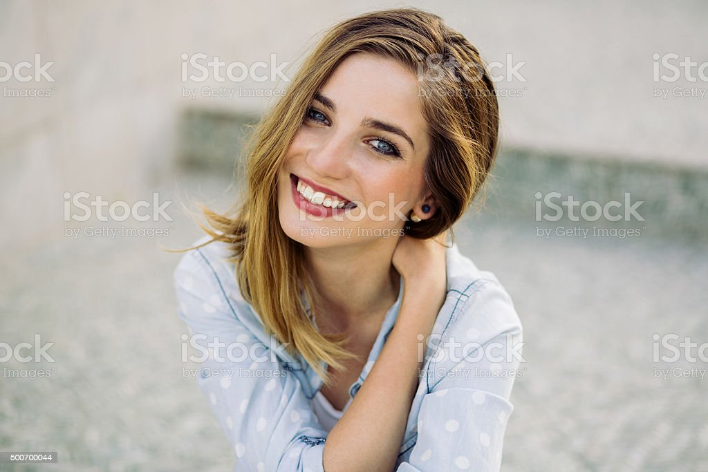 Portrait of a girl with a charming smile stock photo