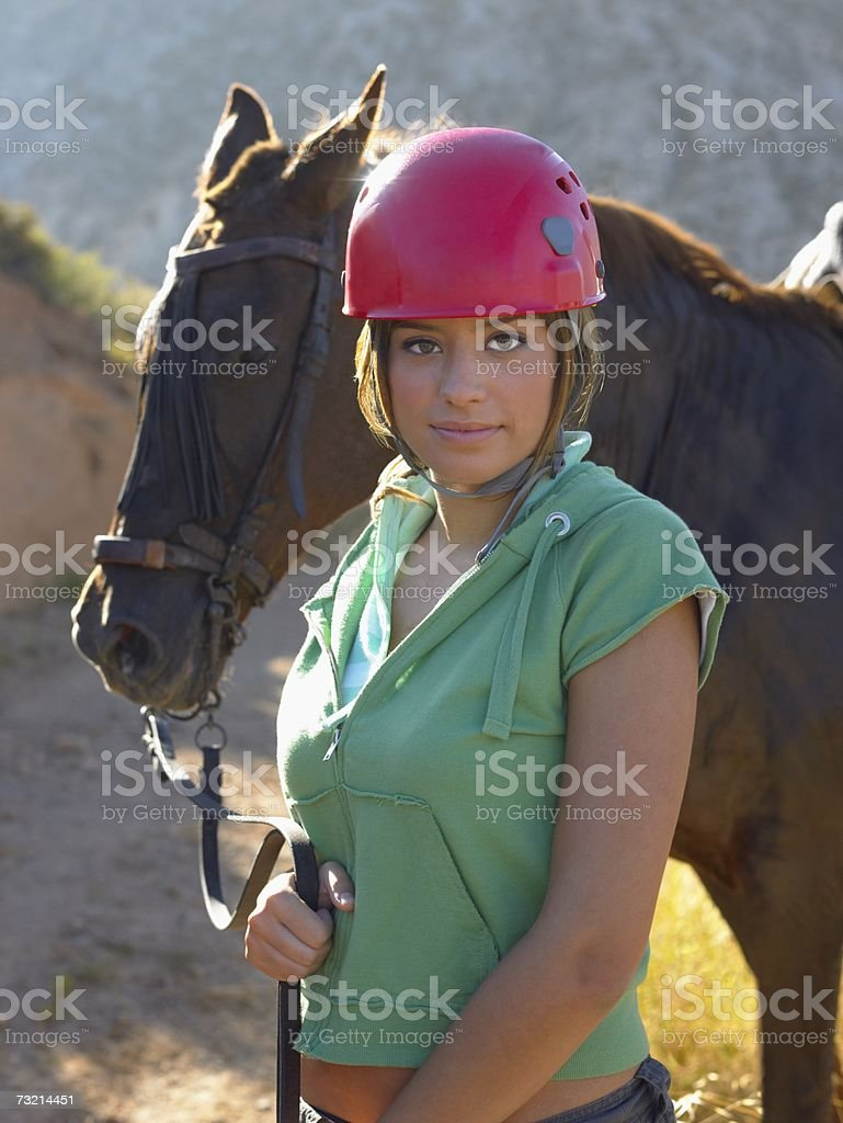 Portrait of a girl with a horse stock photo