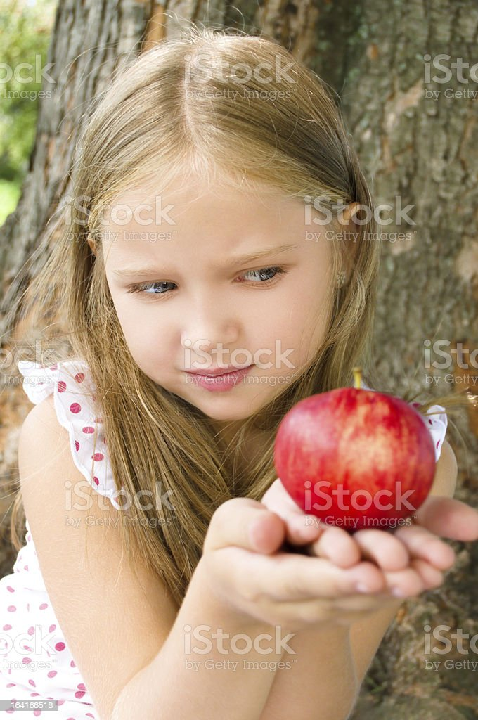 Portrait of a girl with apple royalty-free stock photo