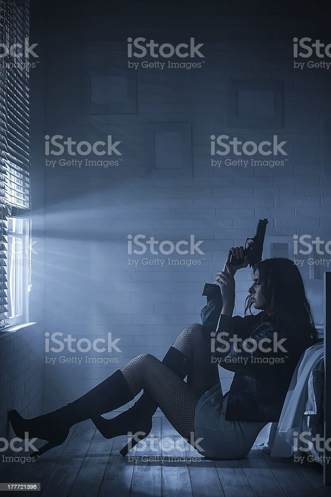 Portrait of a girl with gun royalty-free stock photo
