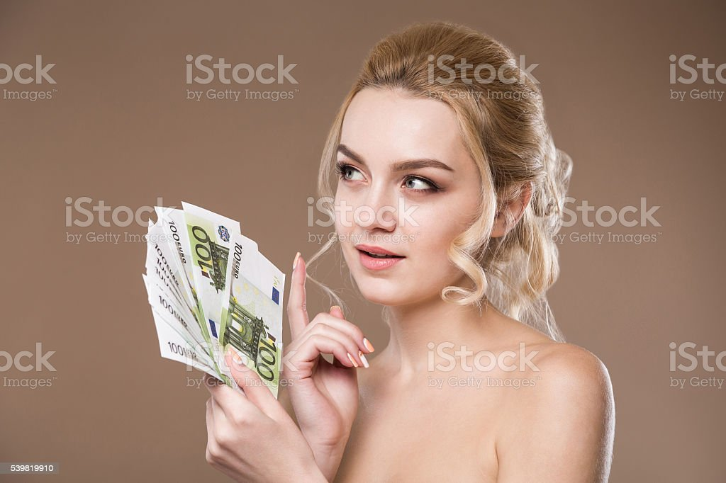 portrait of a girl with money in hand stock photo