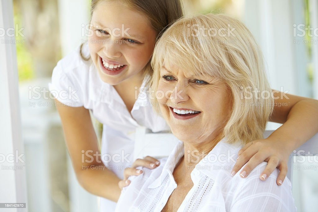 Portrait of a grandmother with granddaughter smiling royalty-free stock photo