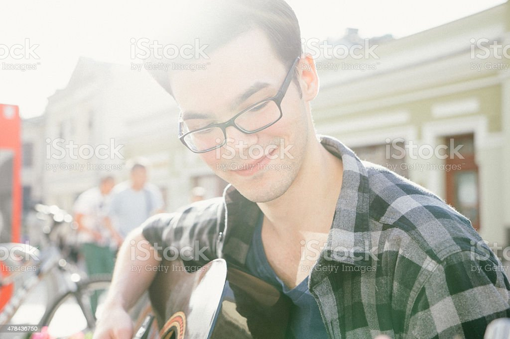 Portrait Of A Guitar Player Outdoors stock photo