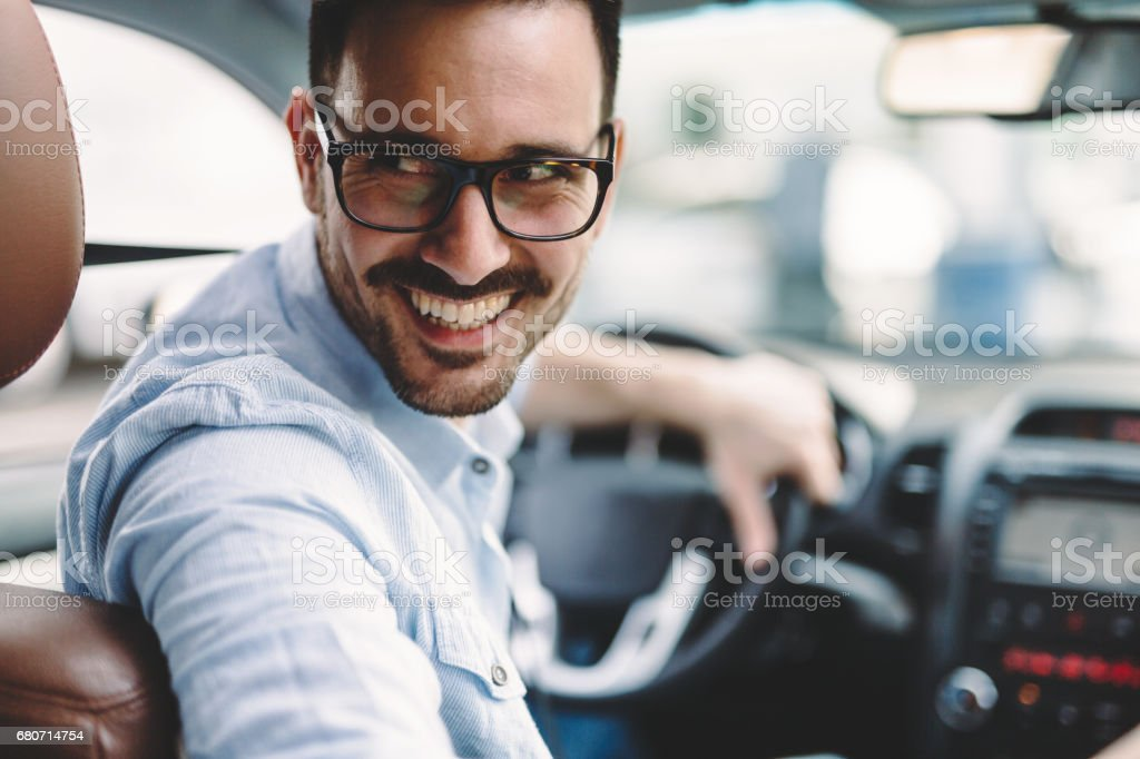 Portrait of a handsome businessman driving car stock photo