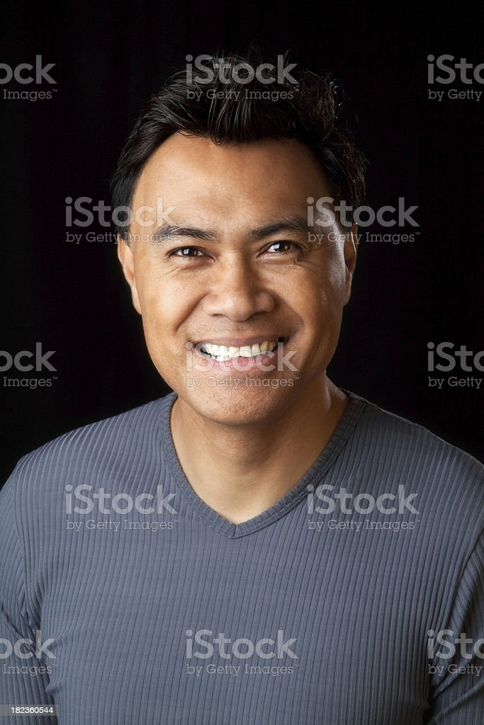 Portrait of a handsome Hawaiian man on black background stock photo