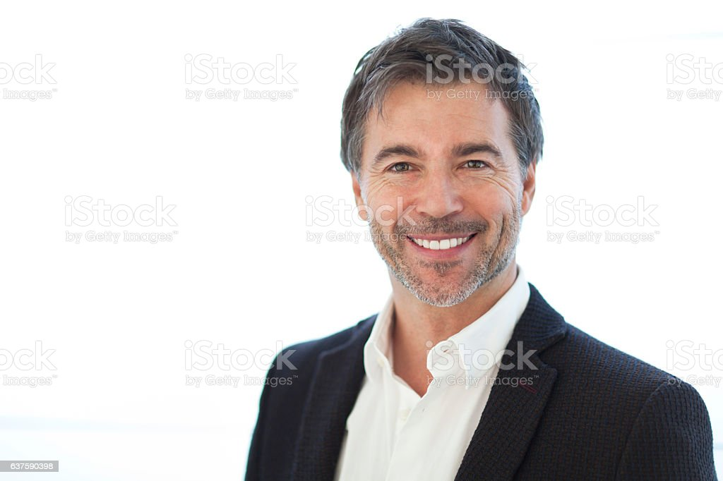 Portrait Of A Handsome man Isolated On white. Smiling stock photo