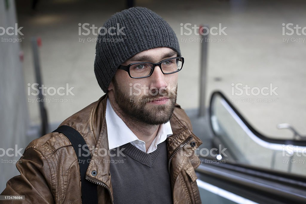 portrait of a handsome man stands on an escalator royalty-free stock photo