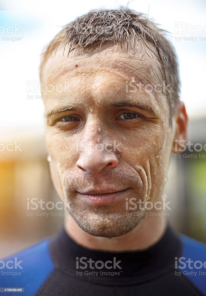 Portrait of a handsome young man in  diving suit stock photo