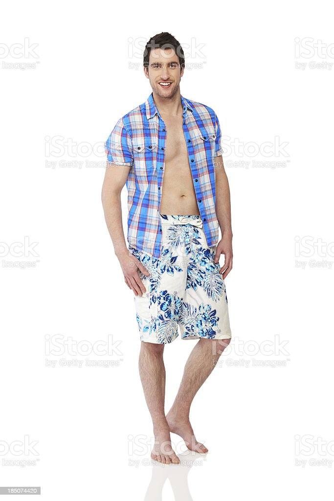 Portrait of a handsome young man in shorts on white royalty-free stock photo