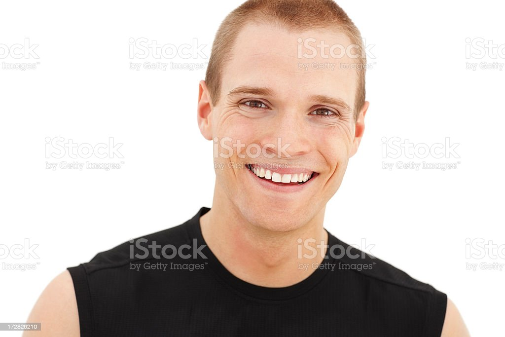 Portrait of a handsome young man smiling over white background stock photo