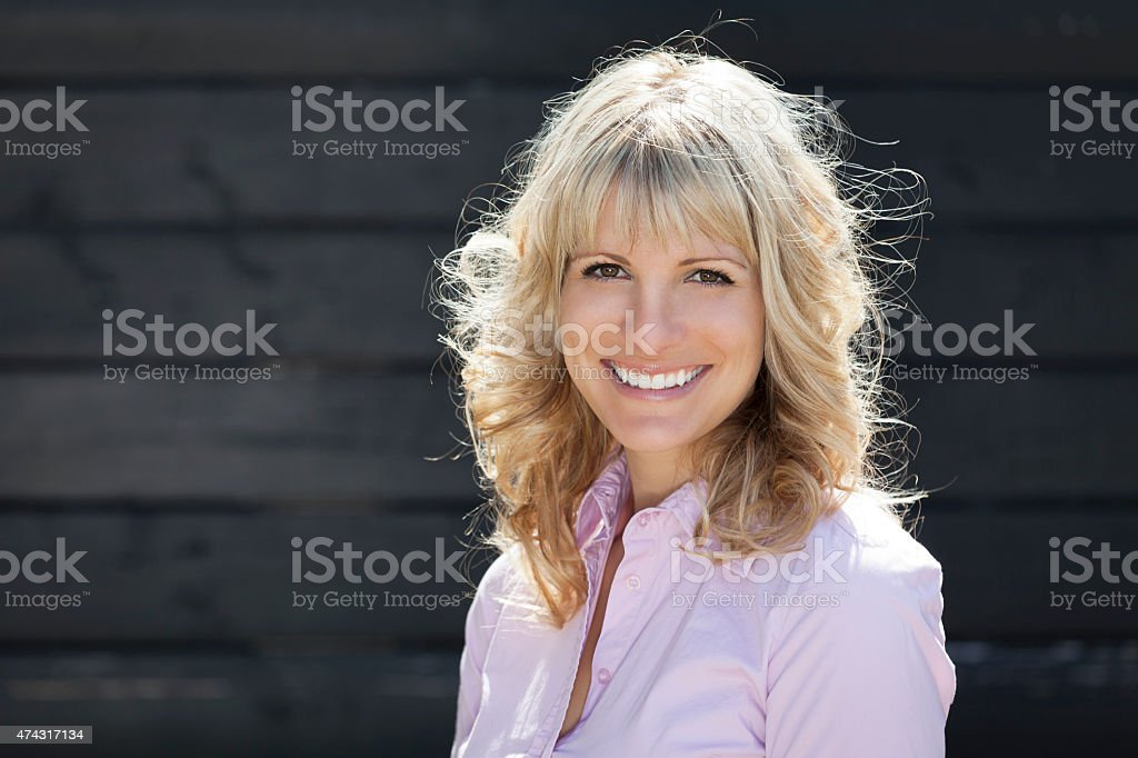 Portrait Of A Happy Blond Woman Outside stock photo