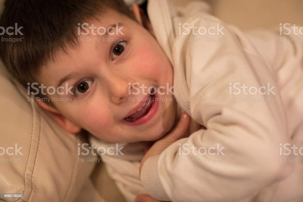 Portrait of a happy boy having fun at home stock photo