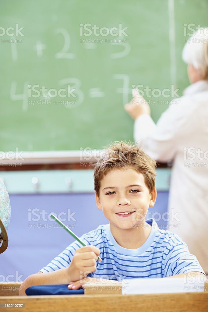 Portrait of a happy boy in his classroom royalty-free stock photo