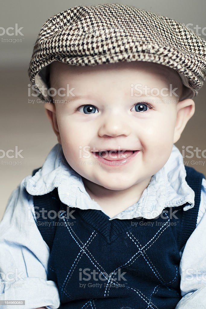 Portrait of a happy boy wearing a sixpence hat stock photo