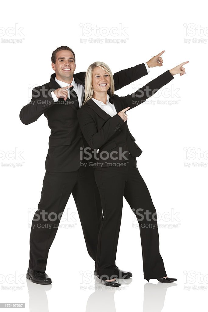 Portrait of a happy business couple gesturing royalty-free stock photo