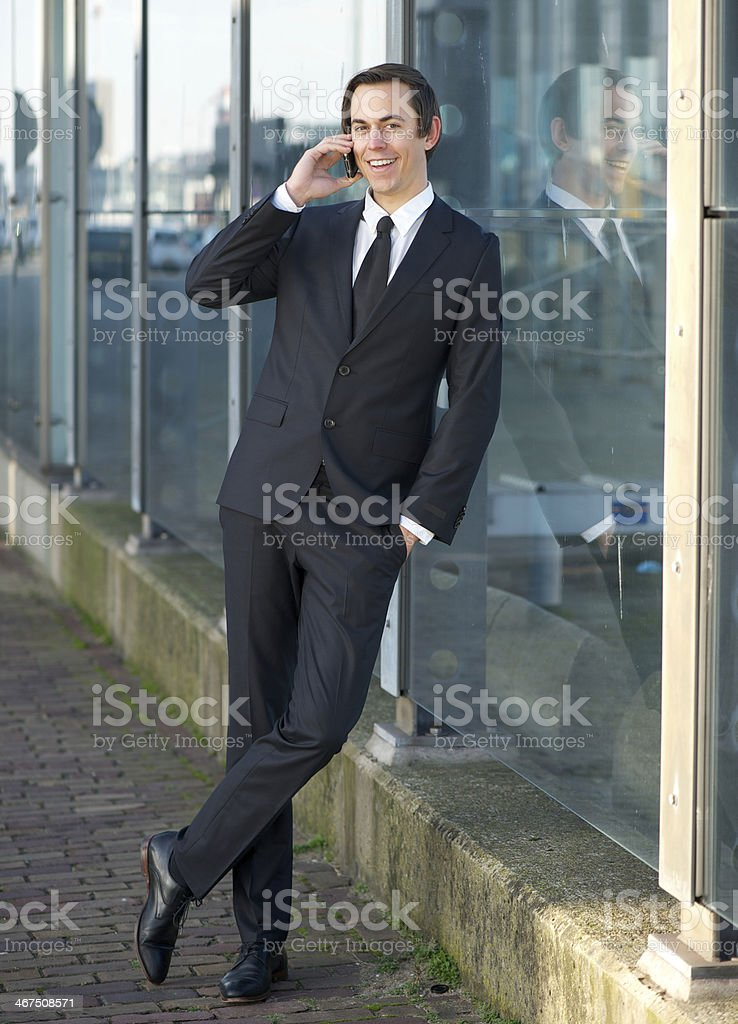 Portrait of a happy business man talking on mobile phone royalty-free stock photo
