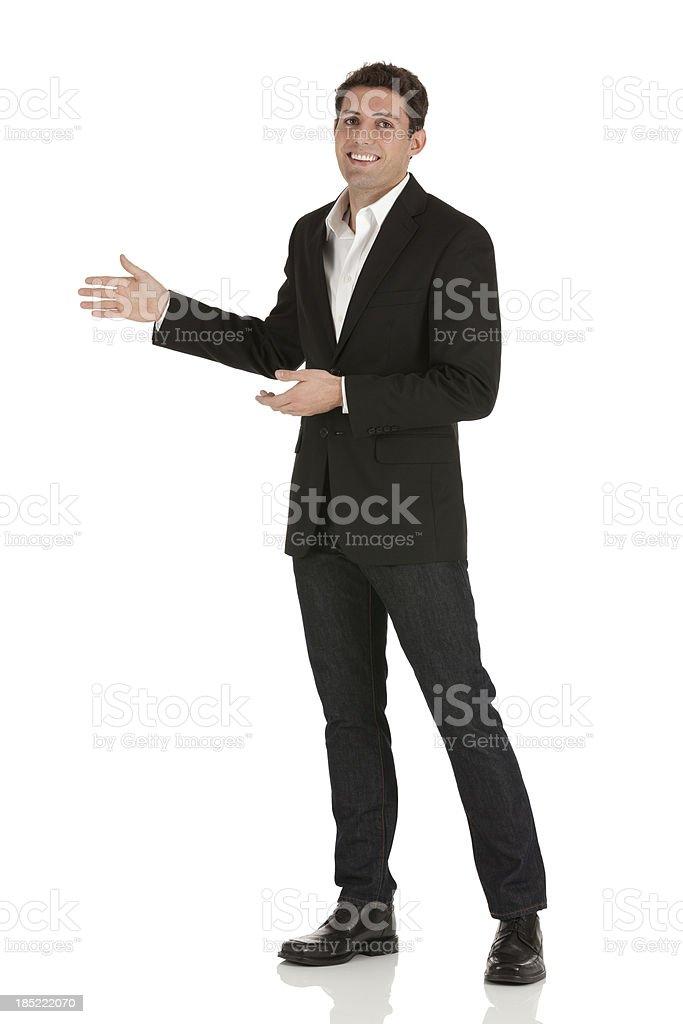 Portrait of a happy businessman gesturing stock photo