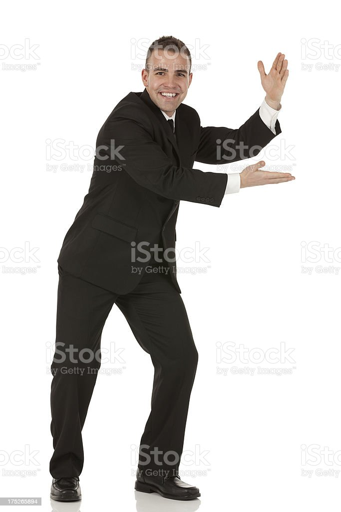 Portrait of a happy businessman presenting royalty-free stock photo