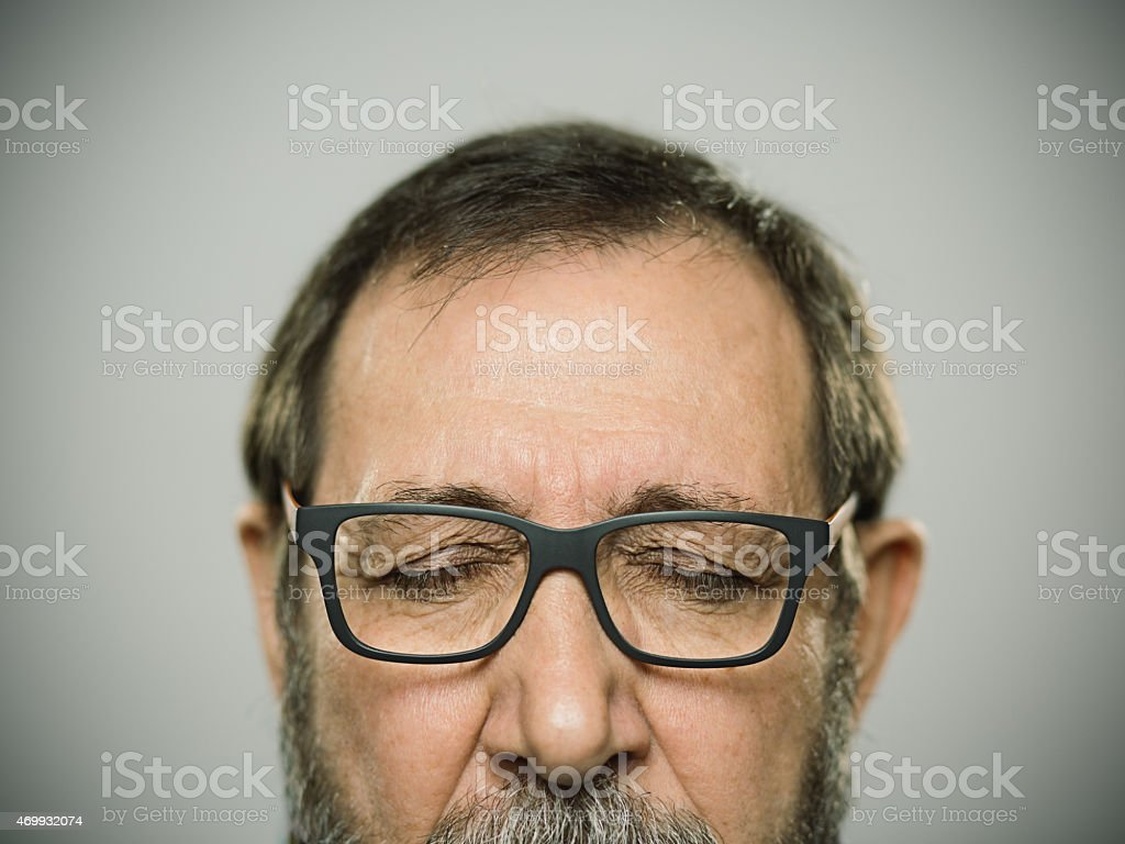 Portrait of a happy caucasian man with glasses and beard. stock photo