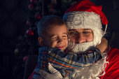 Portrait of a happy child with Santa Claus