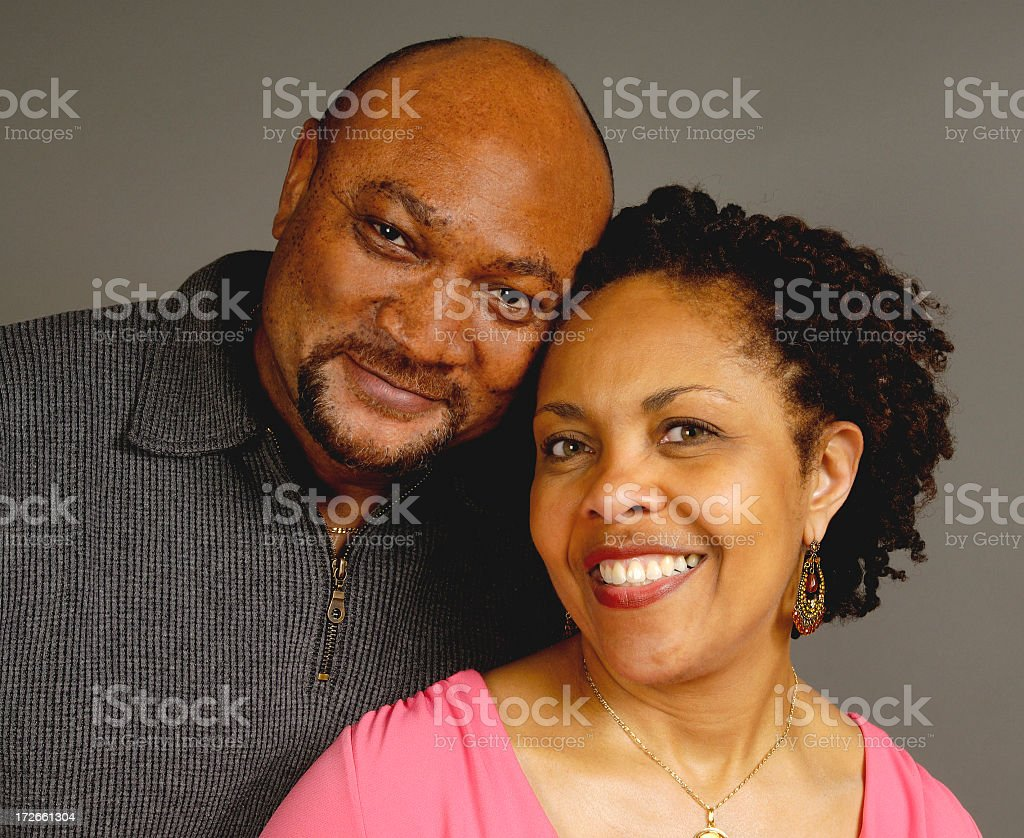 Portrait of a happy couple leaning on each other royalty-free stock photo